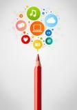 Primer del lápiz con los iconos sociales de la red Imagen de archivo libre de regalías
