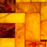 Primer del mosaico ambarino de oro como fondo o textura. Gema. Fotos de archivo libres de regalías
