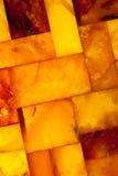 Primer del mosaico ambarino de oro como fondo o textura. Gema. Imágenes de archivo libres de regalías