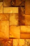 Primer del mosaico ambarino de oro como fondo o textura gema Fotografía de archivo libre de regalías