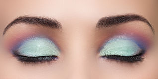 Primer del ojo hermoso de la mujer con maquillaje Foto de archivo