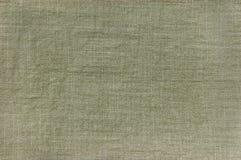 Primer detallado de la textura de color caqui oscura del algodón Fotos de archivo