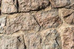 Primer detallado de la textura de piedra marrón de la roca Foto de archivo libre de regalías