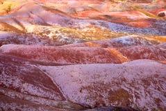 Primer en la tierra coloreada siete - Isla Mauricio Imagen de archivo libre de regalías