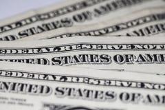 Primer en los billetes de dólar uno Foto de archivo