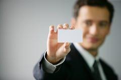 Primer en tarjeta de visita de demostración de la mano Imagenes de archivo