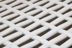Primer, fondo o textura plástico blanco de la parrilla imagenes de archivo