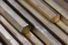 Primer hexagonal de cobre amarillo de las barras Foto de archivo libre de regalías