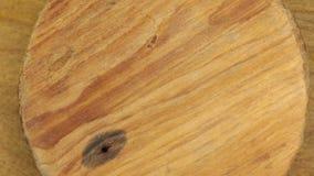 Primer, la rotación de un círculo de madera metrajes