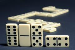 Primer los dominós. Imagen de archivo libre de regalías