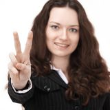 primer mujer de negocios confiada que muestra la muestra de la victoria Aislado en un fondo blanco imágenes de archivo libres de regalías