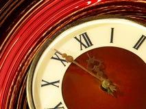 Primer tomado de la cara de reloj del vintage en fondo del extracto del giro Fotografía de archivo