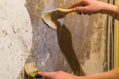 Primer wall repair. Old wall preparation for repair Stock Photos