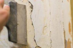 Primer wall repair. Old wall preparation for repair Royalty Free Stock Images
