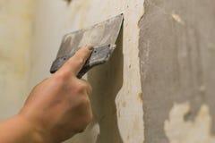 Primer wall repair. Old wall preparation for repair Stock Photo