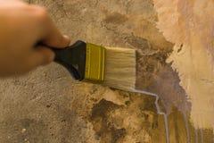Primer wall repair. Old wall preparation for repair Royalty Free Stock Photo