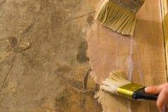 Primer wall repair. Old wall preparation for repair Stock Images