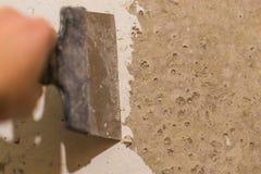 Primer wall repair. Old wall preparation for repair Royalty Free Stock Photos