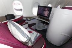 Primera clase de Qatar Airways Imágenes de archivo libres de regalías