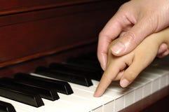 Primera lección de piano Imagen de archivo libre de regalías