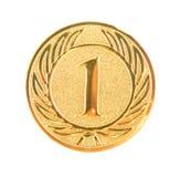 Primera medalla de oro del lugar aislada Imagenes de archivo
