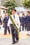 Primero en muchacho de la clase en el evento público Imagen de archivo
