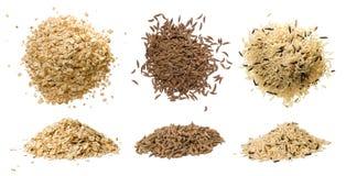 Primi piani della farina d'avena, del riso e del cumino dei prati Fotografia Stock