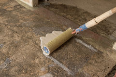 Priming concrete floor Royalty Free Stock Image