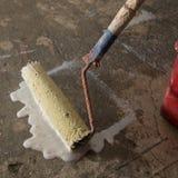 Priming concrete floor Stock Image