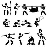 Primitive Ancient Prehistoric Caveman Man. A set of pictogram representing ancient man hunting, making fire, drawing, and using fire Stock Photos