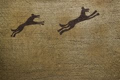 Primitive Animal Drawing. Primitive ancient drawing of two dashing animals. Copyspace provided Stock Images
