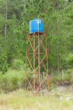 Primitive blue water tower Royalty Free Stock Image