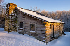 Primitive cabin, Winter scenic, Cumberland Gap National Park. Fresh snow over the old Lige Gibbons Cabin. Located in the Hensley Settlement area of The Stock Photography