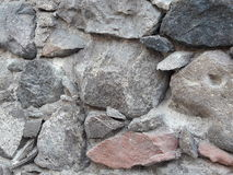 Primitive Dry Stack Style Stone Wall Rustic Background Texture with Old Gray, Pink and Black Colored Mexican Rock Architecture Stock Image