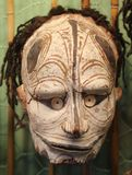Primitive frightening mask from Papua New Guinea, Australia. Primitive old wooden mask from Papua New Guinea in the South Australian museum, Adelaide Stock Photography