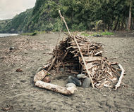 Primitive shelter on the beach. In tropics Royalty Free Stock Photos