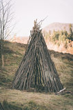 Primitive shelter made from wood. Primitive shelter made from branches Royalty Free Stock Images