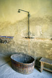 Primitive shower. Remnant of old public shower in former concentration camp Terezin, Czech Republic Royalty Free Stock Photo