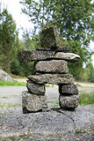 Primitive stone statue Stock Photo