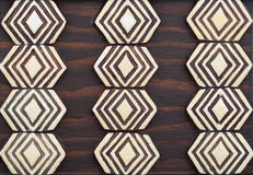 Primitive tribal art brown & ivory wood trivet Royalty Free Stock Images