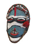 Primitive tribal mask isolated. African primitive, traditional, painted and decorated tribal mask.  Isolated on white Royalty Free Stock Images