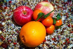Primitive tribe. This is a fruit combination based on miscellaneous grains.Miscellaneous grains arranged to highlight the fruit in the center of the picture stock photography