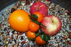 Primitive tribe. This is a fruit combination based on miscellaneous grains.Miscellaneous grains arranged to highlight the fruit in the center of the picture royalty free stock photography