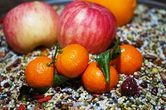 Primitive tribe. This is a fruit combination based on miscellaneous grains.Miscellaneous grains arranged to highlight the fruit in the center of the picture royalty free stock images