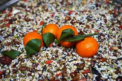 Primitive tribe. This is a fruit combination based on miscellaneous grains.Miscellaneous grains arranged to highlight the fruit in the center of the picture stock images