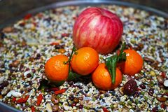 Primitive tribe. This is a fruit combination based on miscellaneous grains.Miscellaneous grains arranged to highlight the fruit in the center of the picture royalty free stock photos