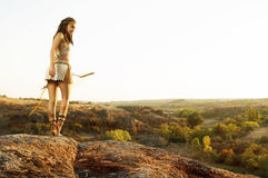 Primitive woman  holding a bow. Amazon woman Stock Photo