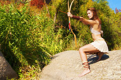 Primitive woman  holding a bow. Amazon woman. Woman warrior. Amazon woman. Warrioress Stock Photo