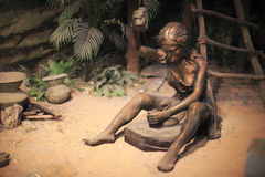 Primitive woman working. The statue of a primitive woman working Royalty Free Stock Photography