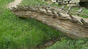 Primitive Wood Footbridge. A primitive wood made footabridge over a tiny water stream stock video